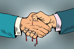 Bloody handshake, underhanded business transaction Stock Photography