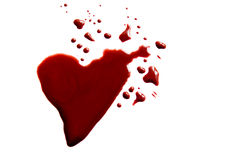 Bloody heart shape puddle. (splatter) isolated on white background Stock Photos
