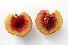 Bloody inside, half cut peach. Metaphor of bloody inside of half peach stock images