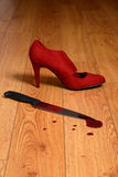 Bloody knife with high heel shoe Stock Photo