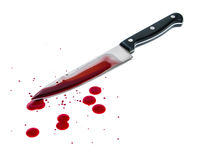 Bloody knife. Bloody kitchen knife, and blood spots on the white background stock images
