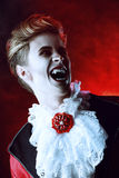 Bloody legend. Handsome bloodthirsty vampire. Halloween. Dracula costume Royalty Free Stock Photos