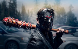 Bloody maniac in hockey mask Royalty Free Stock Images