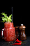 Bloody Mary or  Ceasar with celery in mason jar rimmed  black pepper. Bloody Mary or Bloody Ceasar with celery in mason jar rimmed with black pepper Stock Images