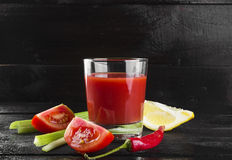 Bloody Mary with celery, lemon, hot pepper on a dark background Royalty Free Stock Images