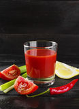 Bloody Mary with celery, lemon, hot pepper on a dark background.  Royalty Free Stock Image