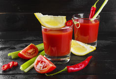Bloody Mary with celery, lemon, hot pepper on a dark background Royalty Free Stock Photos