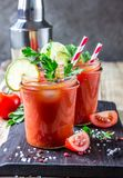 Bloody Mary cocktail. Alcoholic drink and ingredients. On wooden table. Copy space. Selective focus Stock Photos