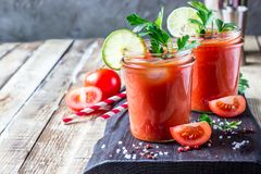 Bloody Mary cocktail. Alcoholic drink and ingredients. On wooden table. Copy space. Selective focus royalty free stock photography