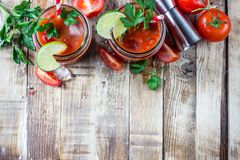 Bloody Mary cocktail. Alcoholic drink and ingredients. On wooden table. Copy space. Selective focus royalty free stock image