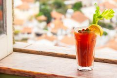 Bloody Mary Cocktail with Celery, Olives, and Lemon Garnish royalty free stock photo