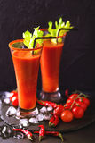 Bloody Mary cocktail with chili pepper, ice and selery. Royalty Free Stock Image