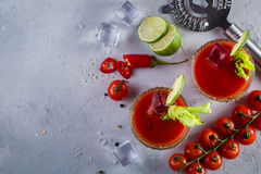 Bloody mary cocktail and ingredients Stock Photography