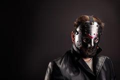 Bloody murderer in hockey mask portrait Stock Photos