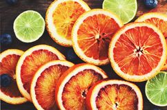 Bloody oranges and limes close up Stock Image