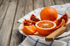 Bloody oranges on the wooden table. Royalty Free Stock Photo
