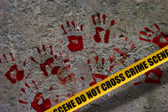 Bloody palm prints. Bloody red palm prints over stone background at crime scene illustrating crime scene concept royalty free stock images