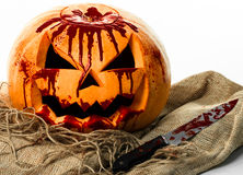 Bloody pumpkin, jack lantern, pumpkin halloween, halloween theme, pumpkin killer, bloody knife, bag, rope, white background, isola Stock Images