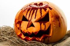 Bloody pumpkin, jack lantern, pumpkin halloween, halloween theme, pumpkin killer, bloody knife, bag, rope, white background, isola Stock Photo