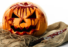 Bloody pumpkin, jack lantern, pumpkin halloween, halloween theme, pumpkin killer, bloody knife, bag, rope, white background, isola Stock Photography