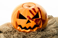 Bloody pumpkin, jack lantern, pumpkin halloween, halloween theme, pumpkin killer, bloody knife, bag, rope, white background, isola Royalty Free Stock Images