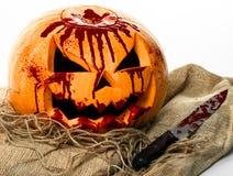 Bloody pumpkin, jack lantern, pumpkin halloween, halloween theme, pumpkin killer, bloody knife, bag, rope, white background, isola Stock Photos