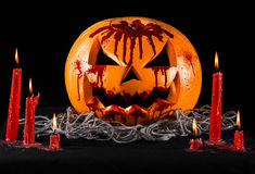Bloody pumpkin, jack lantern, pumpkin halloween, red candles on a black background, halloween theme, pumpkin killer Royalty Free Stock Images