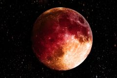 Bloody Red moon in the galaxy background. Science and Planet con. Cept. Full moon and Horror scene theme stock image