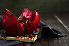 Bloody red ripe pomegranate over traditional pattern Turkish til Stock Photography