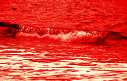 Bloody red wave. Single bloody red wave on water background Stock Image