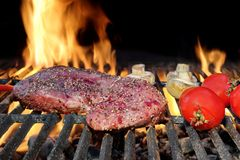 Bloody Strip Steak, Tomatoes And Mushrooms On Hot Grill Royalty Free Stock Photography
