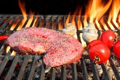 Bloody Strip Steak, Tomatoes And Mushrooms On Hot Grill Stock Images