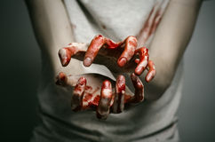 Bloody theme lone murderer: the murderer shows bloody hands and experiencing depression and pain. Studio Royalty Free Stock Photos