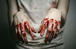 Bloody theme lone murderer: the murderer shows bloody hands and experiencing depression and pain Stock Image