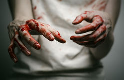Bloody theme lone murderer: the murderer shows bloody hands and experiencing depression and pain. Studio Stock Photos