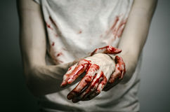 Bloody theme lone murderer: the murderer shows bloody hands and experiencing depression and pain Royalty Free Stock Photos