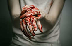 Bloody theme lone murderer: the murderer shows bloody hands and experiencing depression and pain Stock Images