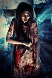 Bloody witch. Bloodthirsty zombi standing at the night cemetery in the mist and moonlight Royalty Free Stock Photo