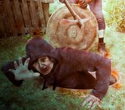 The bloody woman tries to get out of the well and run away from the pursuer royalty free stock images