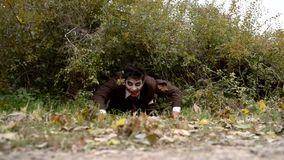 Bloody zombie crawling on the ground stock video footage