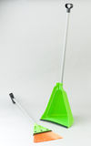 Broom and dust keeper isolated. Green broom and dust keeper lets enjoy your houseworks royalty free stock photo