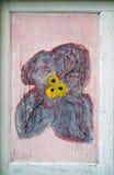 Bloom on a morbid door part. Blue-yellow bloom on a morbid door part Royalty Free Stock Photo