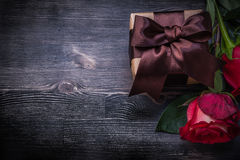 Bloomed roses giftbox on wooden background Stock Photo