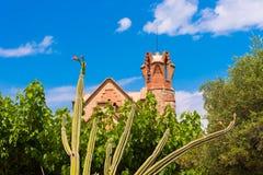 Blooming cactus against the blue sky and church Ermita Mare de Deu de la Riera, Tarragona, Catalunya, Spain Stock Photography