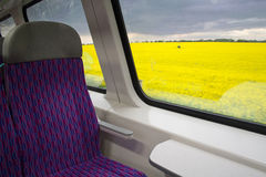 Blooming colza fields outside the train. Blooming rape fields outside the window of the train in the Czech Republic Stock Photo