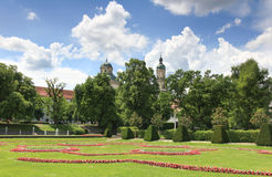 Blooming court garden in spring with church and trees. Blooming court garden in spring with church and trees in background. Kempten, Bavaria, Germany Stock Photography