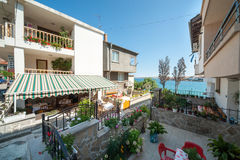 Blooming courtyard in the old town of Sozopol in Bulgaria Royalty Free Stock Photos