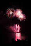 Blooming firework of international firework festival. By mixed color style Royalty Free Stock Images