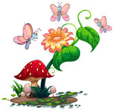 A blooming flower surrounded with three butterflies Stock Photo