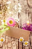 Blooming and flowering sign. On ancient table and blank tag for springtime cards or advertising Royalty Free Stock Image